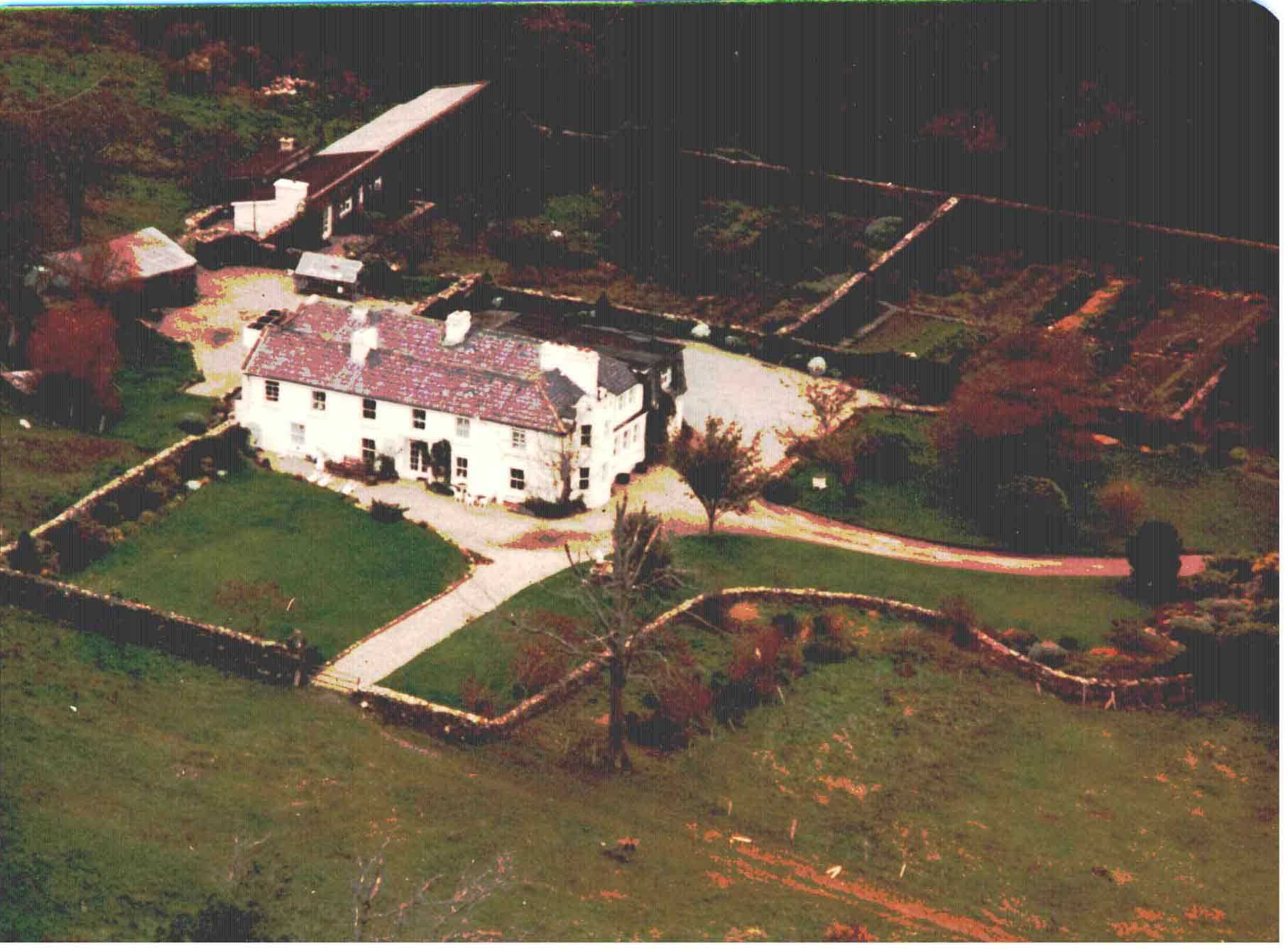 From the air with the Orchard and Walled Vegetable Garden behind